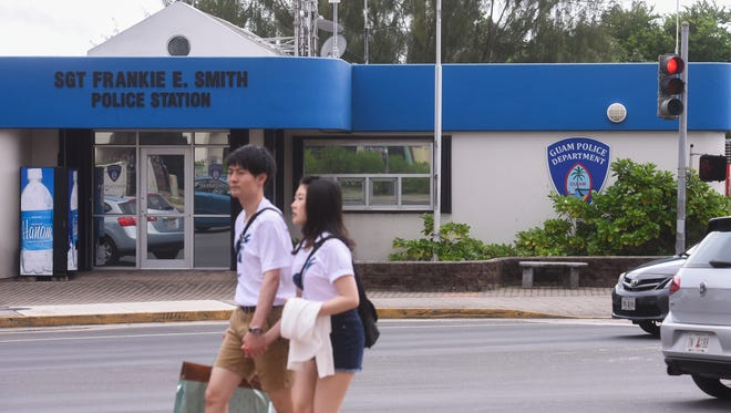 In this July 3 file photo, tourists walk by the Sgt. Frankie E. Smith Police Station in Tumon.
