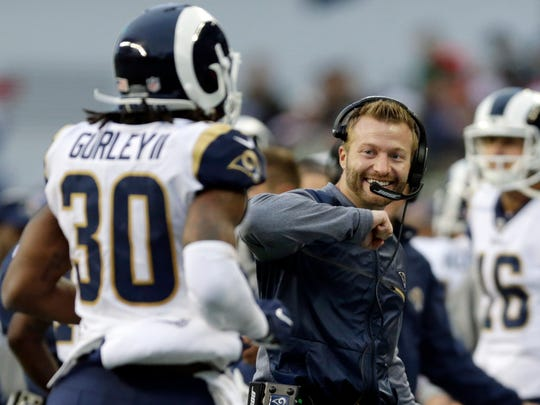 Rams head coach Sean McVay, right, and running back Todd Gurley will get their first taste of the NFL postseason Saturday night.