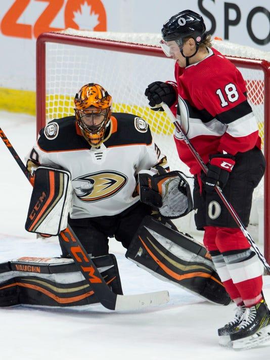 Ottawa Senators left wing Ryan Dzingel tries to screen Anaheim Ducks goaltender Ryan Miller on a shot during the second period of an NHL hockey game Thursday, Feb. 1, 2018, in Ottawa, Ontario. (Adrian Wyld/The Canadian Press via AP)