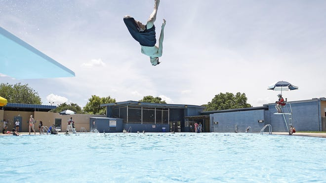 Mason Malone dives into the pool on opening day Tuesday, May 30, 2017, at Maxey Pool in Lubbock, Texas.