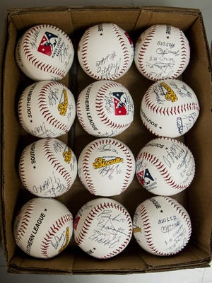 Team autographed baseballs during the Montgomery Biscuits media day at Riverwalk Stadium on April 4, 2017.