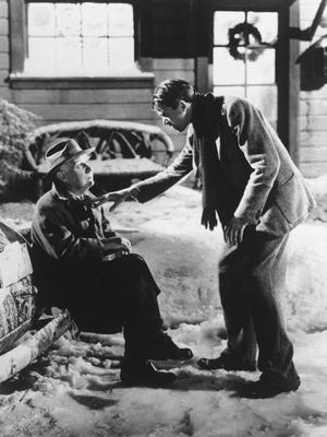 """George Bailey (James Stewart, right) discovers his guardian angel, Clarence (Henry Travers) is trying to show him what the world would be like if he hadn't been born in """"It's a Wonderful Life."""""""