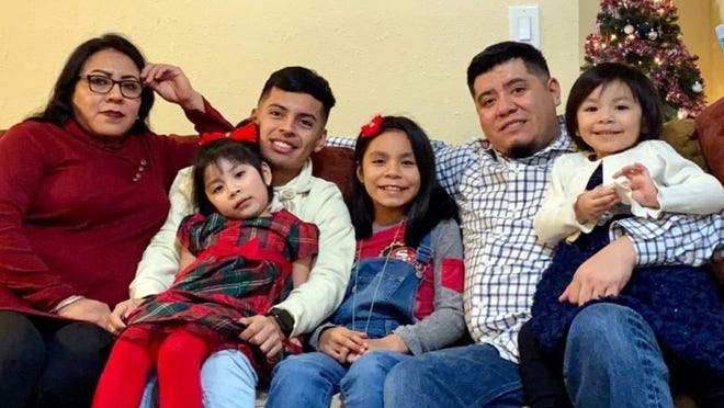 Maria Reyna Flores, left, and Juan Martinez with their children.