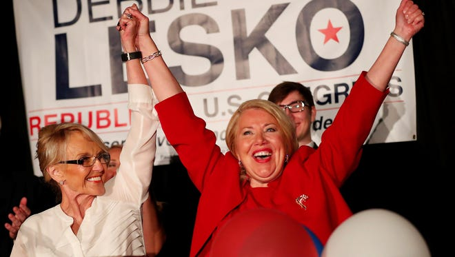 Former Arizona Gov. Jan Brewer celebrates with Republican Debbie Lesko on her win of the 8th Congressional District race on April 24, 2018.