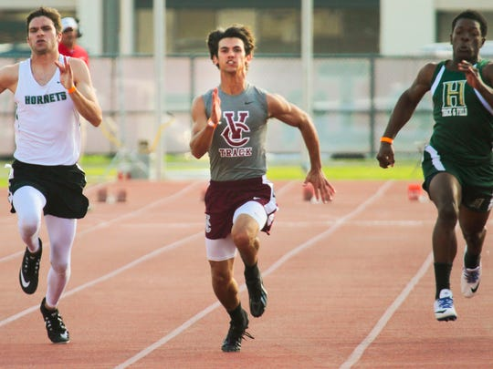 Vermilion Catholic's Emile Trahan on his way to winning the 100-meter dash in the Class 1A regional Tuesday at Cajun Track.