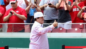 Former Reds great Pete Rose gives a thumbs-up to the crowd as he takes the field at Great American Ball Park before his number 14 was retired on June 26.