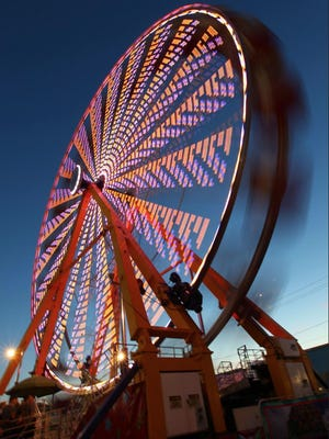 The big Ferris Wheel along the Midway at the New York State Fair is always an attraction to fair-goers.