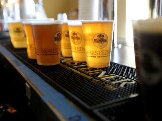 Beers are poured during the ninth annual Wurstfest,