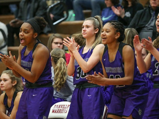 Players on the Brownsburg Bulldogs bench celebrate