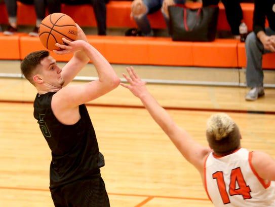 West Salem's Kyle Greeley (5) shoots past Sprague's