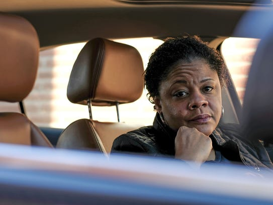 State Rep. Leslie Love sits in her 2009 Saturn on Monday, Feb. 26, 2018, at her home in Detroit that she says she pays more than $5,000 a year in car insurance on for the single vehicle.