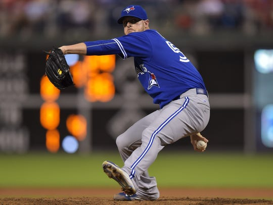 Mark Lowe of the Toronto Blue Jays pitches in a game