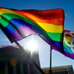 Gay pride flags fly at the Supreme Court on March 27, 2013, in Washington.