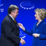 Michael Crow greets Hillary Clinton at ASU event.