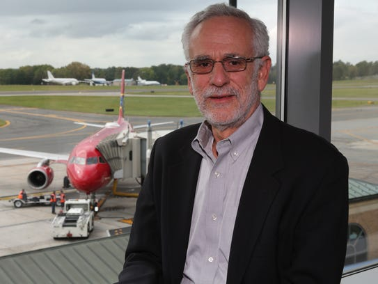 Dr. Martin Seif poses at the Westchester County Airport