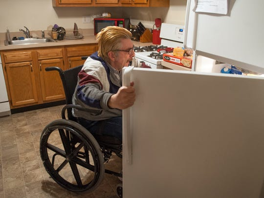 "Andrew ""Andy"" Rooney gathers ingredients to make lunch in the kitchen of his Voorhees home. After suffering a traumatic brain injury, Rooney spent more than 30 years living with his parents in their home. He's now living in a supervised apartment with other patients recovering from brain injuries, and making strides toward independence."