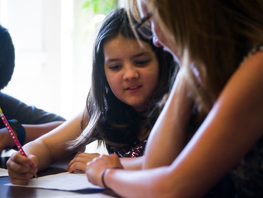 Fourth-grader Mary Ingram, 10, works with her teacher Kathryn Branam in a small group at Fountain City Elementary School a week before TNReady standardized tests are administered April 13, 2017.