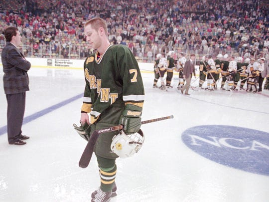 Vermont's Phil Eboli skates dejectedly off the ice after the Catamonts were defeated by Colorado College 4-3 in double overtime in the 1996 Frozen Four in Cincinnati.