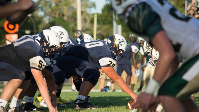 Eau Gallie's Blake McNamee (20) prepares to snap the ball.