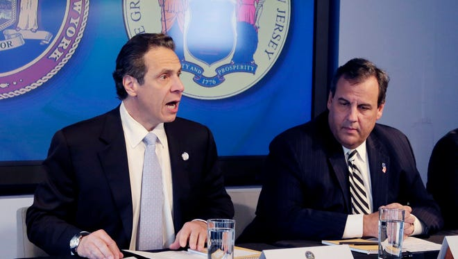 "New York Gov. Andrew Cuomo, left, speaks Oct. 24 as New Jersey Gov. Chris Christie listens at a news conference in New York where the governors announced a mandatory quarantine for people returning to the United States through airports in New York and New Jersey who are deemed ""high risk,"" for contracting Ebola."