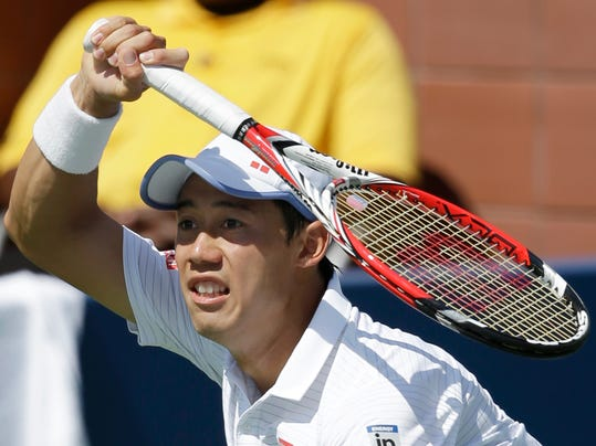 Kei Nishikori, of Japan, returns a shot against Leonardo Mayer, of Argentina, during the third round of the 2014 U.S. Open tennis tournament, Saturday, Aug. 30, 2014, in New York. (AP Photo/Seth Wenig)