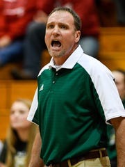 Wood Memorial's head coach Johnnie Bartley yells to his team as the Wood Memorial Lady Trojans play the Gibson Southern Lady Titans in the girls championship game of the Toyota Classic at Gibson Southern Friday, December 23, 2016.