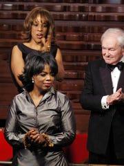 Gayle King applauds as Oprah Winfrey wins another award. The women are best friends.