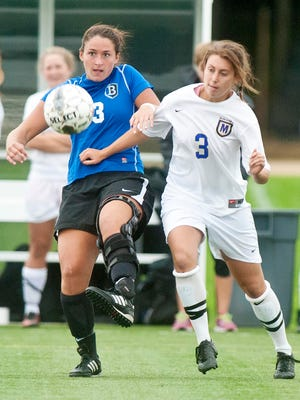 St. Michael's Michaela Horne (right) and Bentley's Sam Ford follow the ball in Colchester on Tuesday, September 23, 2014.