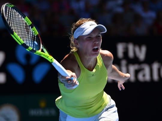 Caroline Wozniacki makes a forehand return to Jana Fett during their second round match at the Australian Open on Wednesday.