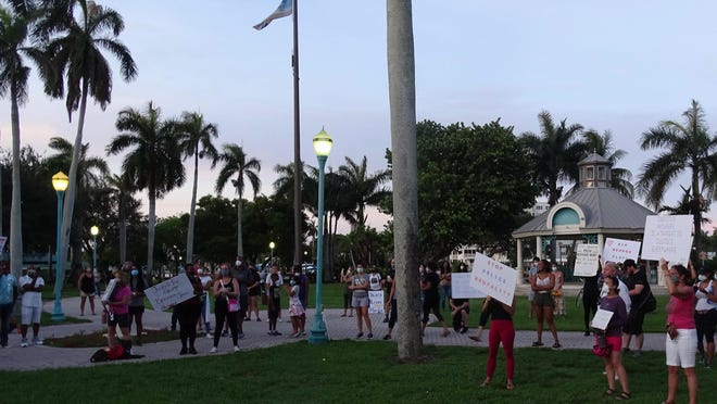 A peaceful vigil in honor of George Floyd took place Sunday evening at Veterans Park in Delray Beach.