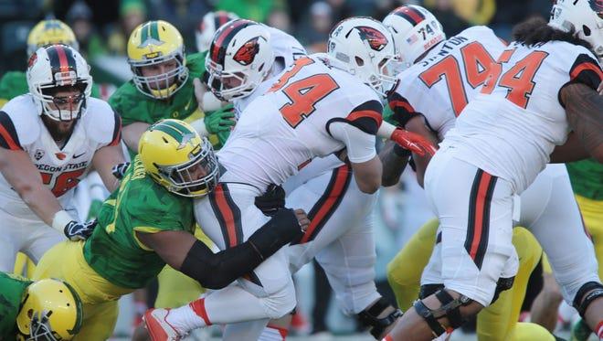 Nov 27, 2015; Eugene, OR, USA; Oregon Ducks defensive lineman DeForest Buckner (44) tackles Oregon State Beavers tight end Ryan Nall (34) at Autzen Stadium. Mandatory Credit: Scott Olmos-USA TODAY Sports
