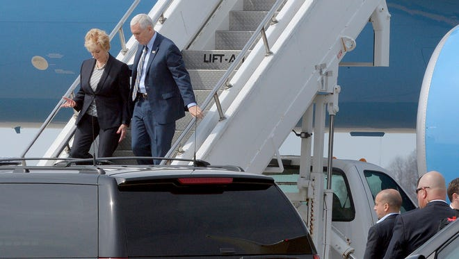 Vice President Mike Pence and Small Business Administrator Linda McMahon arrive at Yeager Airport in Charleston, W.Va., on Saturday, March 25, 2017 to travel by motorcade to Putnam County for a meeting with small business operators.