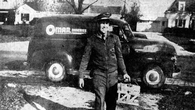 Omar route salesman James Archer delivered baked goods on his route in Indianapolis in 1955.