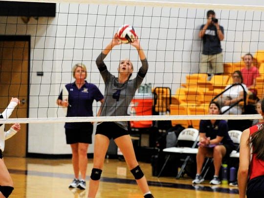 Wylie's Karis Christian pushes the ball over the net during Tuesday's 3-1 loss to Lubbock Trinity Christian.