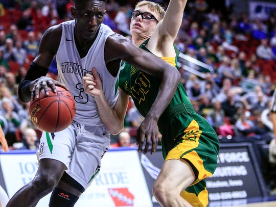 Issa Samake of Grand View Christian drives to the basket