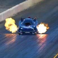 NHRA funny car driver Jack Beckman finished with a record time of 3.921 seconds at 323.43 mph in a Dodge Charger.