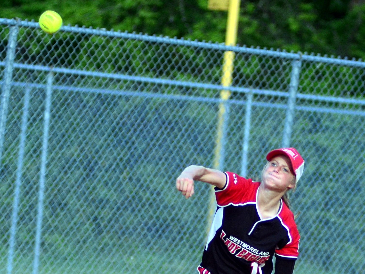Westmoreland High junior shortstop Savannah Whiticker throws to first base during second-inning action.