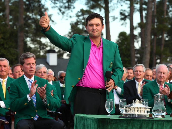 Patrick Reed speaks after receiving his green jacket