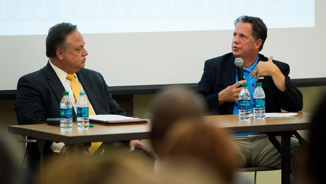 Dee Stanley, chief administrative officer of the Lafayette Consolidated Government, and State Rep. Joel Robideaux, both candidates for City-Parish President, speak during a candidate forum at the downtown branch of the Lafayette Public Library in downtown Lafayette, LA, Wednesday, Sept. 2, 2015. The forum was hosted by the Downtown Development Authority and the Freetown-Port Rico, LaPlace, and McComb-Veazey Coteries to focus on issues impacting those areas.