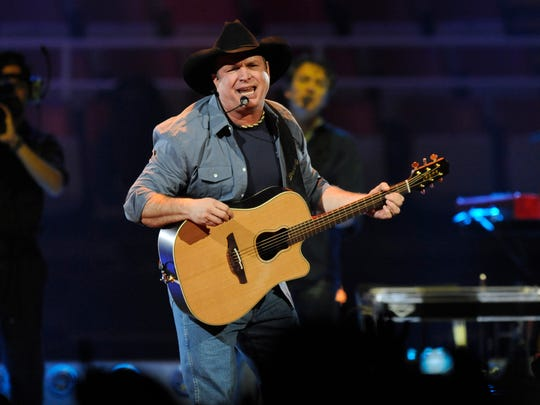 Garth Brooks performs for the crowd at Joe Louis Arena.