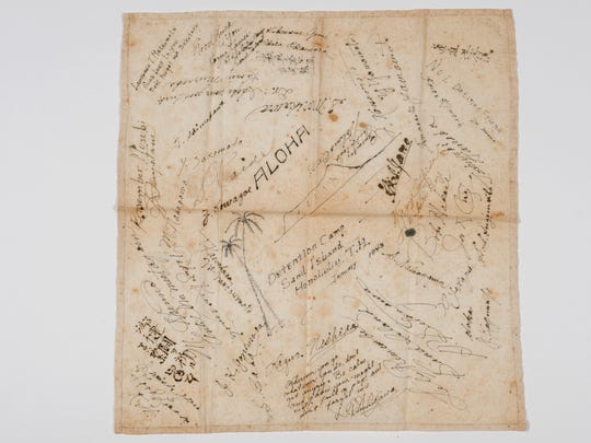 This July 12, 2016 photo provided by the Japanese Cultural Center of Hawai'i / Stanford Masui Family Archival Collection shows a white cotton handkerchief with messages to Tamotsu Masui by fellow internees at the Sand Island Internment Camp. It was given to Masui as he was about to leave the Honolulu camp in January 1943. (Brian Y. Sato/Courtesy of the Japanese Cultural Center of Hawai'i / Stanford Masui Family Archival Collection via AP)