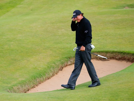 Phil Mickelson reacts after a missed eagle chance on the 16th hole Sunday.