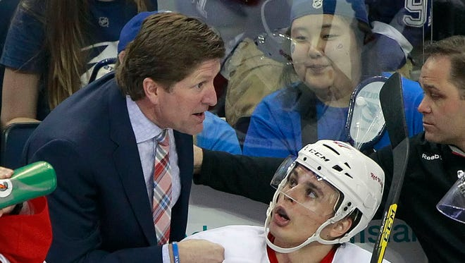 Detroit Red Wings coach Mike Babcock, left, talks with defenseman Alexey Marchenko during a game at Amalie Arena.