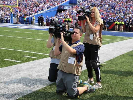 WHAM news videographer Jenna Cottrell  (standing) along