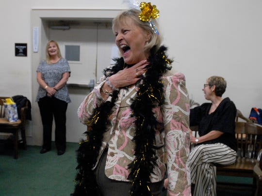 Norma Hurst laughs while hearing a story told by Judge