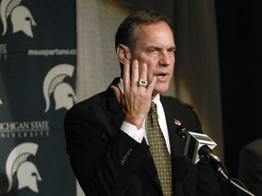 Newly hired  MSU head football coach Mark Dantonio  shows the National Championship ring he earned as a defensive coordiator  at Ohio State as he  talks  during his  press conference at  MSU  on Nov. 27, 2006.