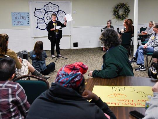Yvonne Brambrink tells her story during a gathering
