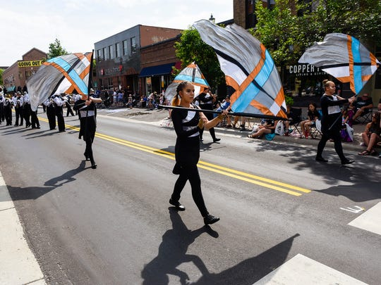 The flags of the St. Cloud Solar Sound Marching Band perform for the crowd June 23, 2018, during the Granite City Days Parade in St. Cloud.