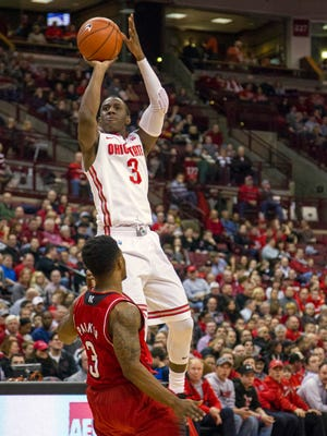 Ohio State Buckeyes guard Shannon Scott (3) shoots the ball as Nebraska Cornhuskers guard Benny Parker (3) defends in the first half of the game at Value City Arena.