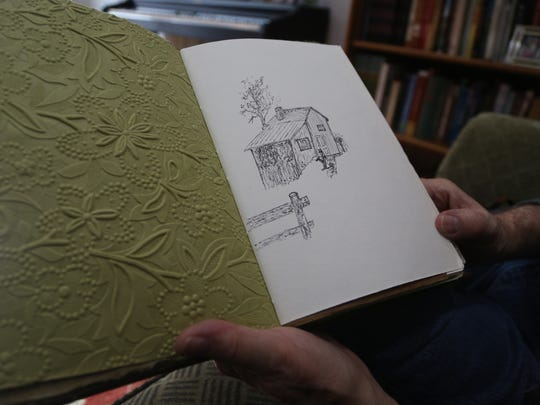Bruce Hopkins, 75 of Sioux City, opens his journal